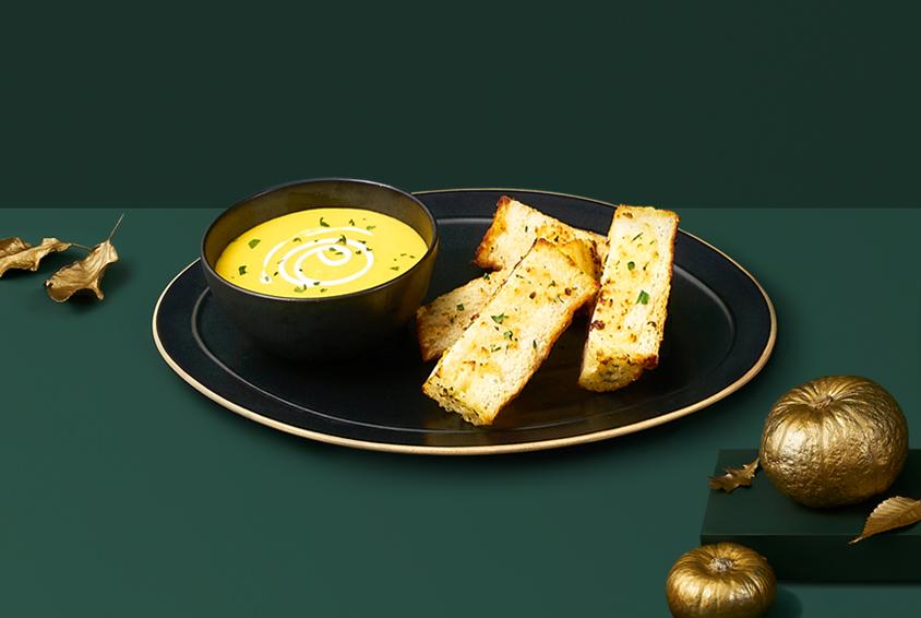 Golden Pumpkin Soup with Garlic Bread Stick